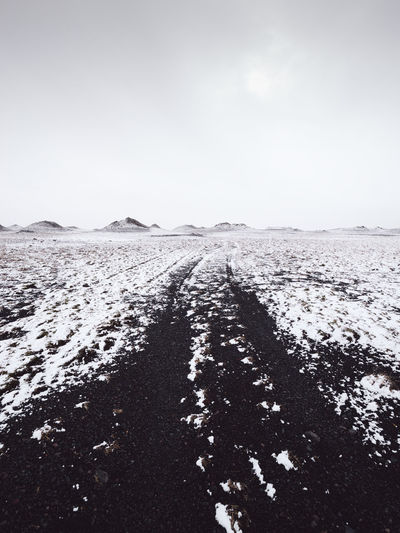 scenic view of snow covered land against clear sky Ice Iceland Moon Landscape Winter Winterscapes Wintertime Beach Cold Temperature Day Direction Dirt Environment Iceland Trip Land Landscape Nature No People Outdoors Philipp Dase Road Scenics - Nature Sky Snow Snowcapped Mountain The Way Forward Tranquil Scene Tranquility Transportation Winter The Traveler - 2018 EyeEm Awards