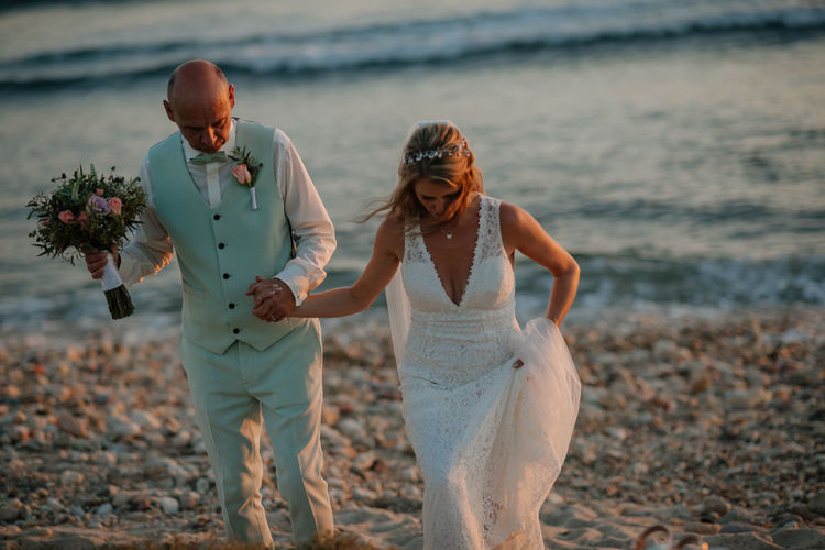 Wedding couple couple standing at sea shore