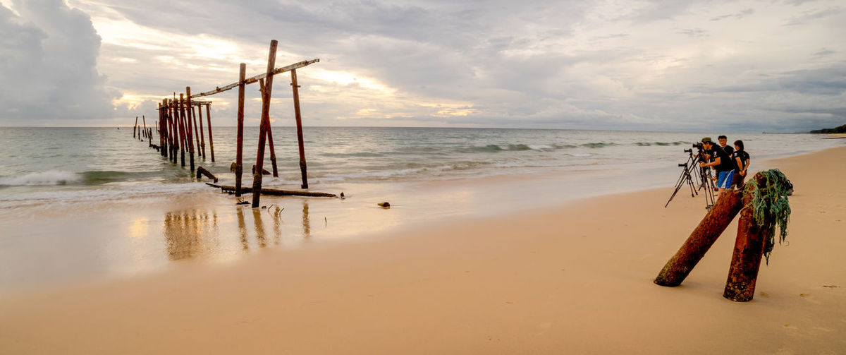 Khao Pilai Beach, Thailand Famous Landmark Famous Tourist Attractions Gang Beach Beauty In Nature Cloud - Sky Day Famous Landmarks Famous Place Famous Places Horizon Over Water Men Nature Outdoors People Photographers Sand Scenics Sea Sky Sunset Tranquility Tripods Water