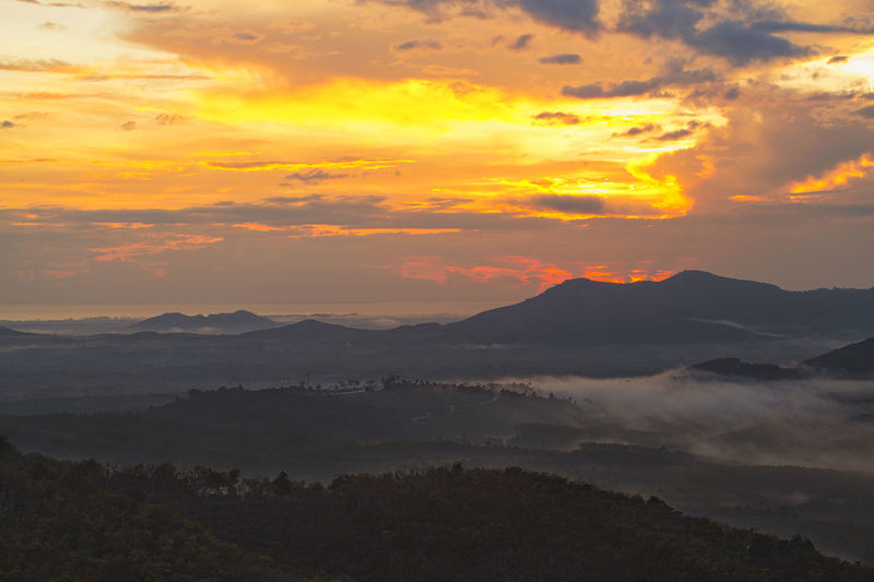 Morning sunrise over mountain Vacations Aerial View Beauty In Nature Cloud - Sky Day Environment Hazy  Idyllic Landscape Mist Mountain Mountain Range Nature No People Outdoors Scenics Season  Sky Sunrise Sunset Tranquil Scene Tranquility Tree