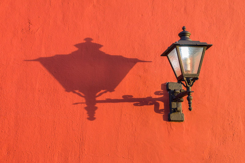 Electric Lamp With Shadow On Wall