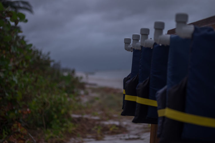 Beach Cloud - Sky Clouds Day Focus On Foreground In A Row Land Life Vest Nature No People Outdoors Sea Selective Focus Sky Water Wood - Material