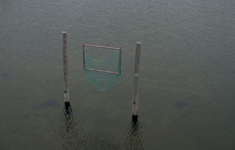 High angle view of soccer ball on lake