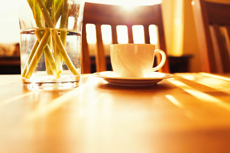 close-up of coffee cup on table in restaurant Close-up Coffee Coffee - Drink Coffee Cup Crockery Cup Drink Eating Utensil Februar Food And Drink Freshness Glass Indoors  Mug No People Refreshment Restaurant Saucer Still Life Sunlight Surface Level Table Tea Tea Cup Tulpen