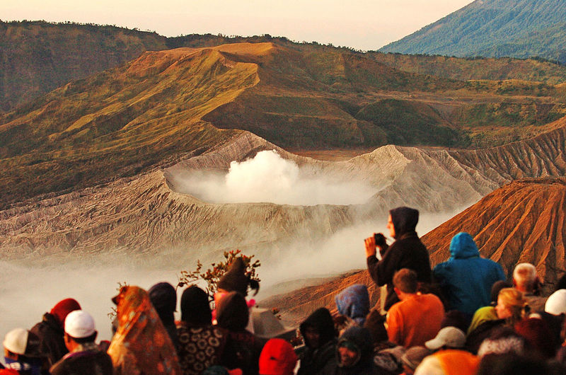 Tourists enjoy the sunrise of mount bromo in east java, indonesia