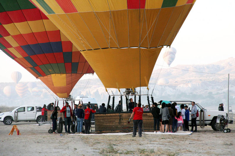 Hot Air Balloons Adventure Air Vehicle Crowd Day Flying Group Of People Hot Air Balloon Land Large Group Of People Leisure Activity Lifestyles Men Mode Of Transportation Nature Outdoors Real People Sky Transportation Travel