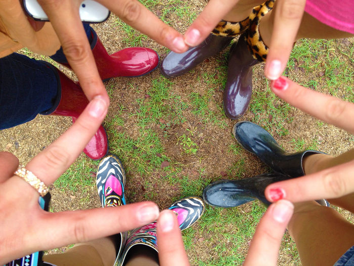 EyeEmNewHere Fingers Friendship Grass Hand Signs Human Hand Leisure Activity Outdoors Personal Perspective Rain Boots Rain Boots In This Weather Real People Standing Togetherness