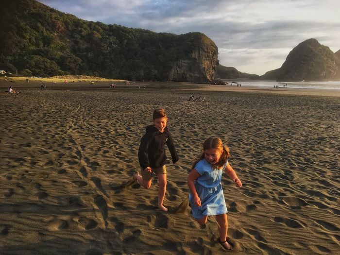 My kids playing 😘 Warm Day Black Sand Beach New Zealand Beach Piha Beach Beach Photography EyeEm Selects Childhood Beach Land Child Sand Boys Togetherness Casual Clothing Leisure Activity Family Sky