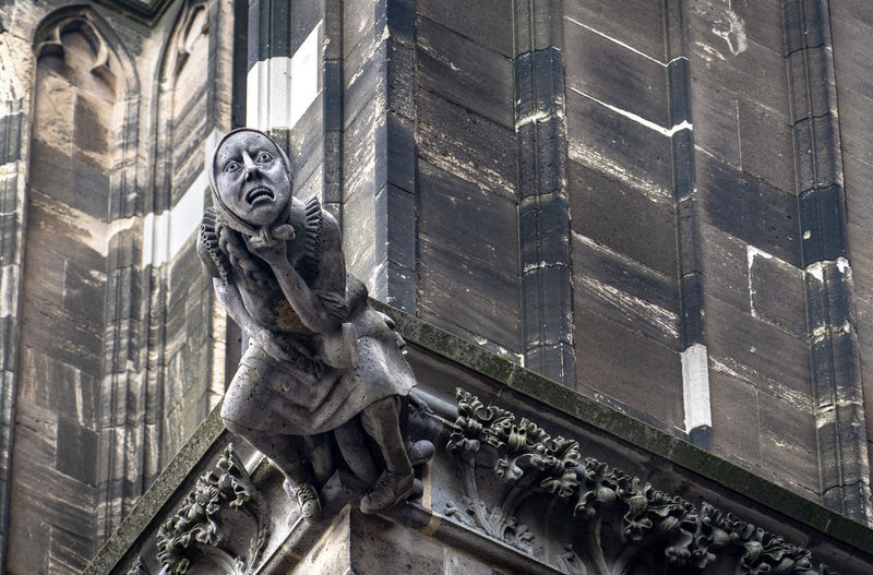 Statue Sculpture Representation Art And Craft Architecture Human Representation Craft Built Structure Male Likeness Creativity Building Exterior The Past History Building Low Angle View No People Day Carving - Craft Product Religion Outdoors Gargoyle
