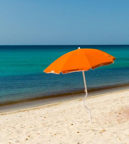 Parasol At Beach Against Clear Sky