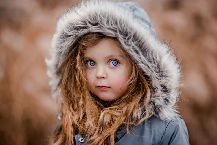 Blue Eyes Child Childhood Children Only Close-up Curly Hair Day Eye Color Fur Hood Headshot Looking At Camera One Girl Only Outdoors Portrait Uniqueness