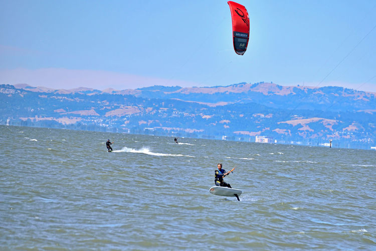 Kiteboarding In San Mateo 14 San Francisco Bay Kiteboaders Kite Surfing Wind Power Sail Power Marin Headlands Aquatic Sports Watersports Riding The Wind Enjoying Life Foggy Colorful Sails Marine Layer Sports Photography