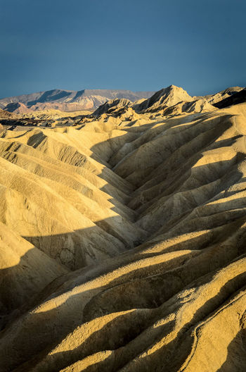 Death Valley Death Valley National Park Silhouette Zabriskie Point Arid Climate Beauty In Nature Day Desert Landscape Light And Shadow Mountain Mountain Range Nature No People Outdoors Physical Geography Scenics Shadow Sky Yellow EyeEmNewHere California Dreamin