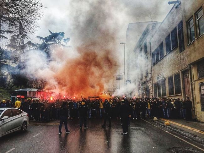 Fenerbahçe Taraftarı #derbi Football Time  Istanbul Football Match Football Fans Derbi  Fenerbahce  Smoke - Physical Structure Real People Building Exterior Large Group Of People Architecture Men Built Structure People