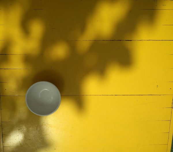sun and shadow play on garden brunch table #sunandshadow #shadowplay #sunkiss #One #bowl #White #ceramics #table #tablewwre #teatime #garden Table #under The Tree #tea #Bright #sunnyday #summer #sunning Yellow Yellow Background Full Frame Backgrounds Condensation Shadow Close-up