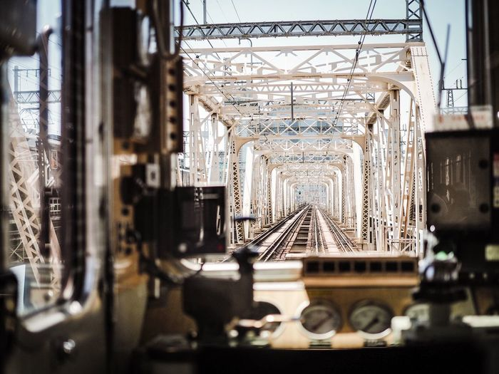 EyeEmNewHere Railroad Track Rail Transportation Track Train Selective Focus Architecture Indoors  Built Structure No People Focus On Background Connection Bridge Window EyeEmNewHere