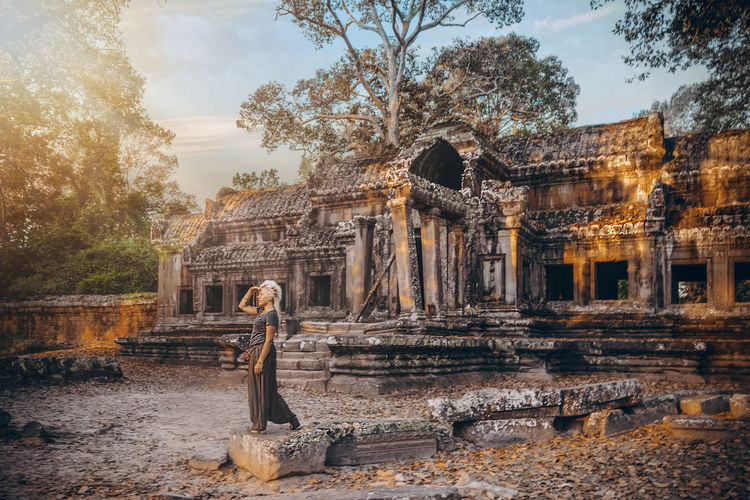 Sunrise in Angkor Wat, Cambodia Ancient Ancient Civilization Archaeology Architecture ASIA Building Exterior Built Structure Cambodia Girl History Human Representation Nature No People Old Ruin Outdoors Place Of Worship Religion Sky Spirituality Statue Tourism Travel Travel Destinations Tree First Eyeem Photo Connected By Travel Lost In The Landscape Be. Ready. Summer Exploratorium