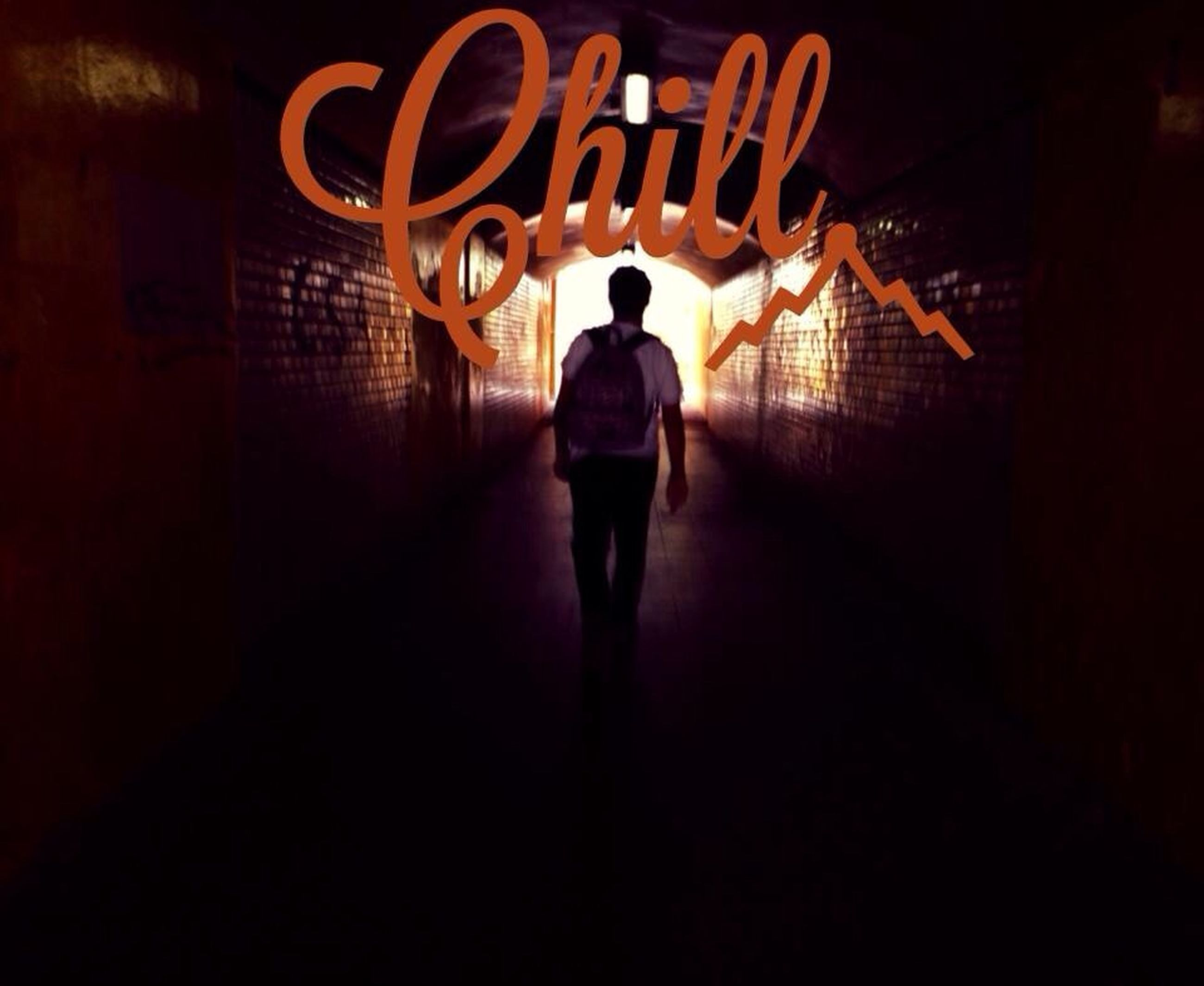 illuminated, lifestyles, indoors, men, full length, rear view, walking, night, standing, built structure, wall - building feature, silhouette, architecture, tunnel, leisure activity, dark, text, unrecognizable person