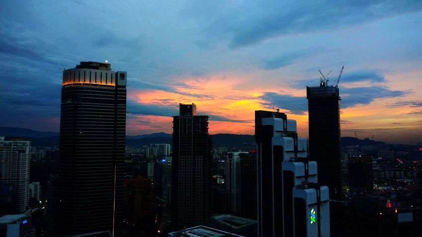 Before Dusk at Kuala Lumpur. EyeEm Selects Skyscraper Sunset Urban Skyline Architecture Illuminated Cityscape Downtown District Business Finance And Industry City Building Exterior Cloud - Sky Dramatic Sky Travel Destinations Development Sky City Life No People Office Building Exterior Modern