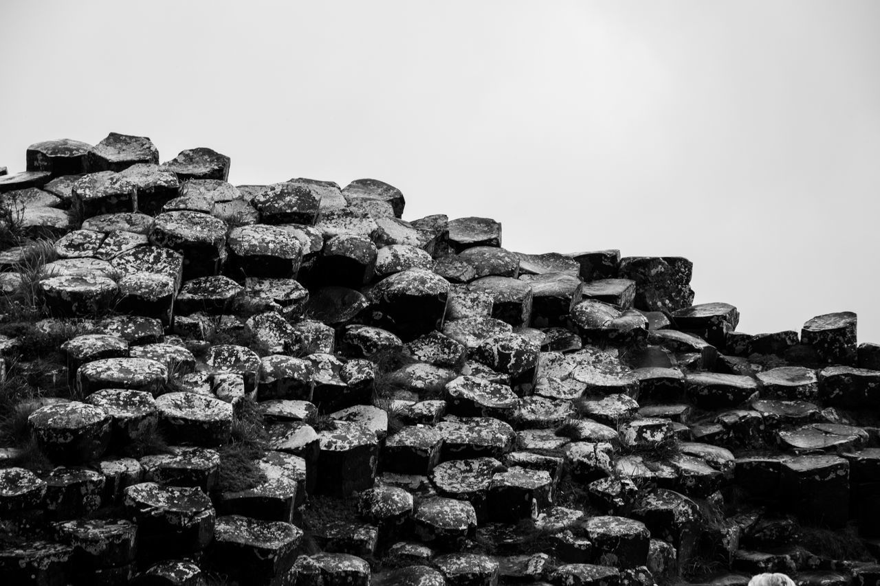 sky, no people, clear sky, day, copy space, nature, architecture, built structure, abundance, solid, large group of objects, outdoors, stack, low angle view, history, stone wall, the past, rock, rock - object, ancient