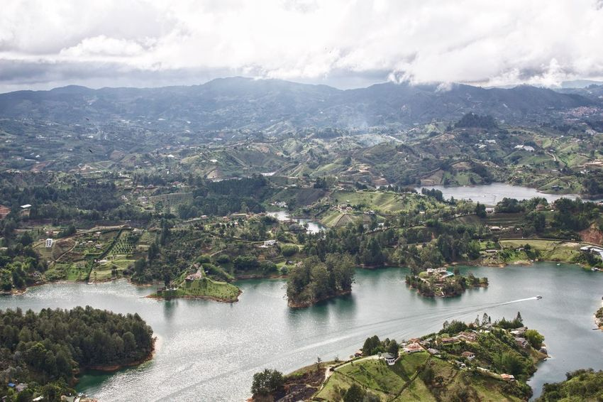 Guatape Colombia 6 Swinginginaplumtree Guatapé Reservoir Birdview Islands View From Above Colombia Beauty In Nature Sky Mountain Nature Scenics Tree Beauty In Nature Landscape High Angle View Tranquil Scene Day Cloud - Sky No People Tranquility Outdoors Water Mountain Range Forest Architecture