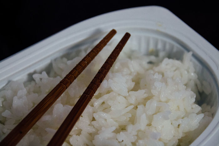 Backgrounds Black Chopsticks Close Up Close-up Convenience Food Deli Detail Easycooking Food Food And Drink Freshness Indoors  Mealtime Part Of Precooked Food Ready-to-eat Rice Selective Focus Simplicity Still Life Taste Good Textures And Surfaces White