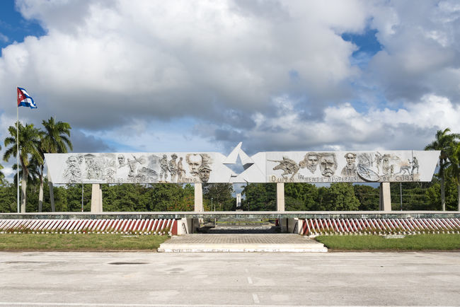 Revolution Square. The place is a sculptural and architectural complex where the remains of Calixto Garcia, a Cuban Hero, are guarded. Calixto Garcia Cloud - Sky Communism Cuba Cuban Day Flag History Landmark No People Outdoors Patriotism Plaza Revolution Revolution Square Sightseeing Socialism Square Symbol Tourism Tourist Attraction  Travel Tropical Vacations