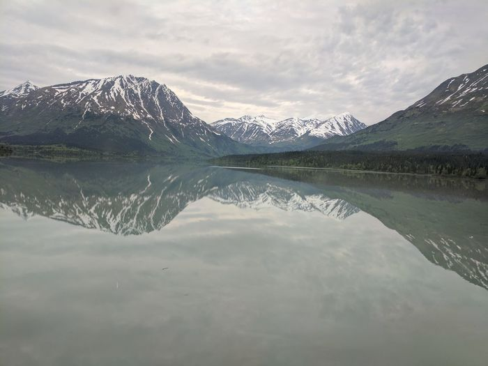 EyeEmNewHere Reflection Mountain Lake Water Tranquility Tranquil Scene Scenics Nature Sky Mountain Range Cloud - Sky Day Landscape No People Beauty In Nature Symmetry Outdoors Alaska Train Cold Temperature Alaskanadventures Adventure Travel Destinations Travel The Traveler - 2018 EyeEm Awards The Great Outdoors - 2018 EyeEm Awards