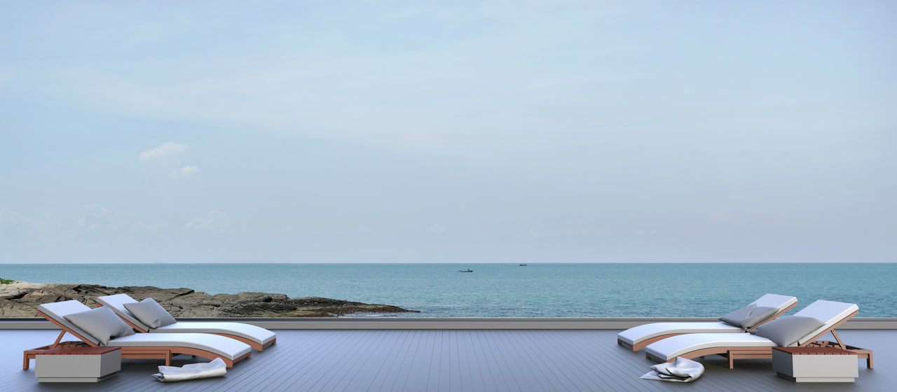 Beach lounge outdoor on Sea view and Sky in Holiday Water Sea Horizon Over Water Sky Horizon Scenics - Nature Beauty In Nature Table Tranquil Scene Tranquility No People Day Chair Nature Cloud - Sky Copy Space Beach Publication Idyllic Outdoors Sundeck Summer Lounge Beach Relaxing Seascape