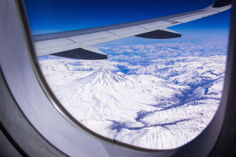 Airplane Snow Air Vehicle Cold Temperature Airplane Wing Rockmountain Fly Flying High Illuminator Blue Tranquil Scene Wing Space Landscape Aeroplane Aircraft Flying Clouds Mountains Rocks Scenics Winter Beauty In Nature Illuminated Seascape