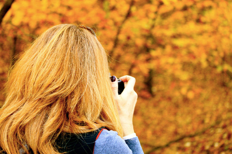 Female photographer capturing an autumnal scene in rural Indiana park. Autumn Colors Autumn Leaves Camera - Photographic Equipment Nails Strawberry Blonde Adult Autumn Blond Hair Brown Color Change Day Hand Headshot Leisure Activity Lifestyles Long Hair Nature One Person One Woman Only Outdoors People Photographer Real People Rear View Women Be. Ready. The Portraitist - 2018 EyeEm Awards