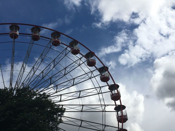 EyeEm Selects Amusement Park Cloud - Sky Arts Culture And Entertainment Sky Ferris Wheel Low Angle View Amusement Park Ride Day Leisure Activity Outdoors Silhouette Tree Big Wheel No People
