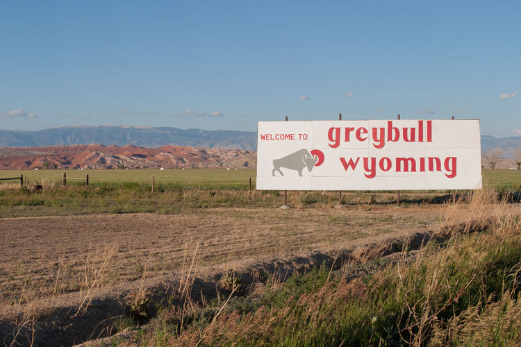 Arriving into Greybull, Wyoming America Americana Blue Clear Sky Copy Space Grass Greybull Information Information Sign Landscape Non-urban Scene Remote Road Sign Roadside Roadside America Rural Rural Scene Scenics Sign Signboard United States USA Wyoming