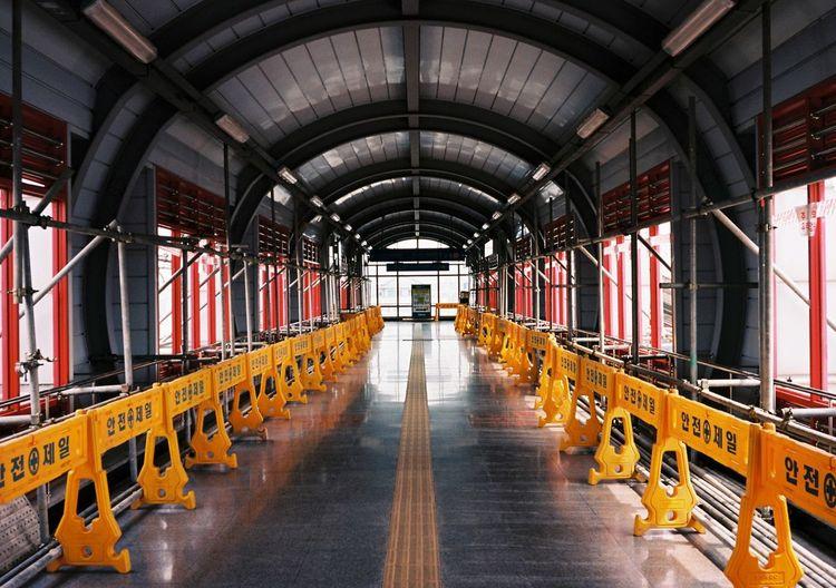 Barricades in empty covered footbridge