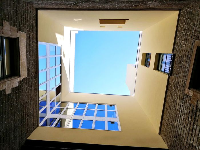 Look up and feel the art coming down Architecture Lookingup Geometric Shape Geometry Politics And Government Spiral Staircase Prison Window Architecture Built Structure Building Exterior Sky Entryway Directly Below Skylight Geometric Shape Ceiling Rectangle Triangle Hexagon The Mobile Photographer - 2019 EyeEm Awards The Architect - 2019 EyeEm Awards