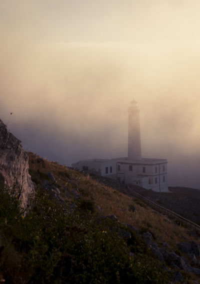 Architecture Beauty In Nature Day Fog Landscape Lighthouse Monument Mountain Nature News Event No People Outdoors Scenics Sky Sunset Tranquility Travel Destinations