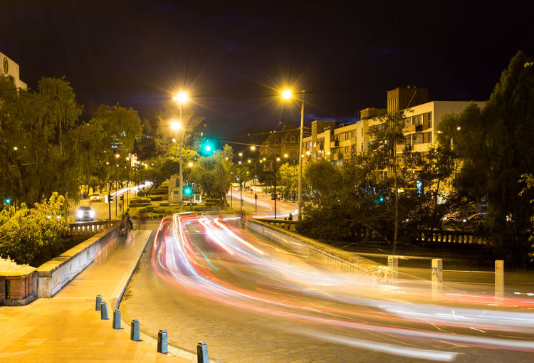 Azuay Tomebamba Traffic Architecture Blurred Motion Bridge Building Exterior Buildings Built Structure City High Street Illuminated Light Trail Long Exposure Motion Night No People Outdoors Road Speed Street Light Transportation Tree Urban