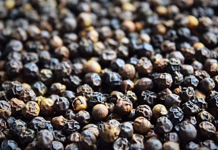 Full frame shot of black peppercorns on table