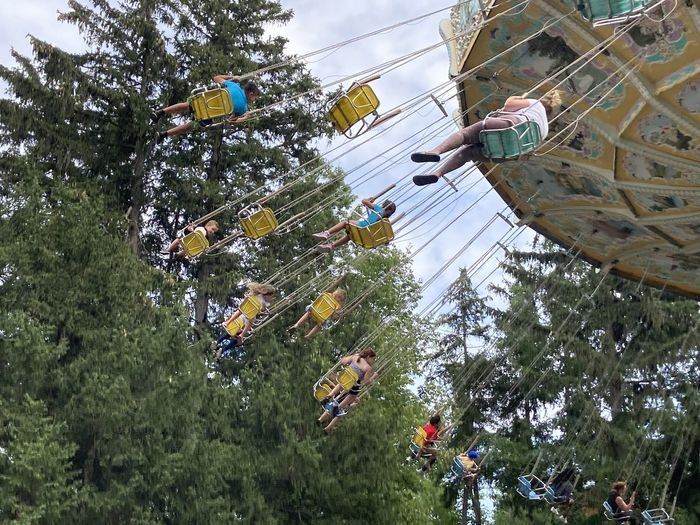 Low angle view of people at amusement park