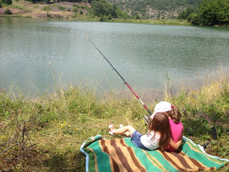 Boat Casual Clothing Family Fishing Fishing Time Girls High Angle View Lake Leisure Activity Lifestyles Nature Nautical Vessel Person Rear View Relaxation River Sister Sisters Sitting Tranquility Travel Vacation Water