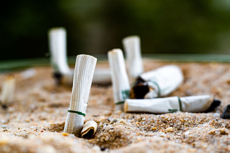 Close-Up Of Cigarette On Sand
