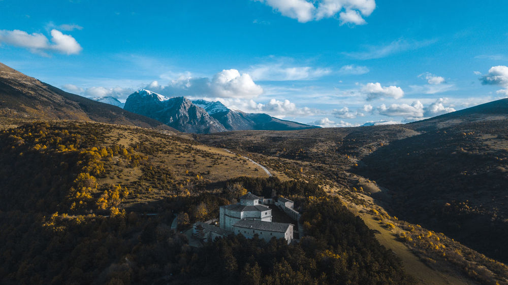 like a bird DJI Mavic Pro Drone  Macereto, Italy Postcard Architecture Arialphotography Beauty In Nature Building Exterior Built Structure Cloud - Sky Day Environment Landscape Mountain Mountain Peak Mountain Range Nature No People Non-urban Scene Outdoors Scenics - Nature Sky Tranquil Scene Tranquility Travel Destinations