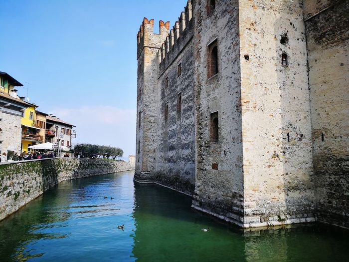 Stone and water Picoftheday Sunday Trip Voyage Hello World Stepbystep Architecture Aroundtheworld Landmark Colours Site Storia Historicsite Water Reflection Sky Architecture Building Exterior Built Structure Old Town TOWNSCAPE Historic Medieval Fortress Fortified Wall Postcard Castle Fort Ancient Civilization Civilization Pilgrimage