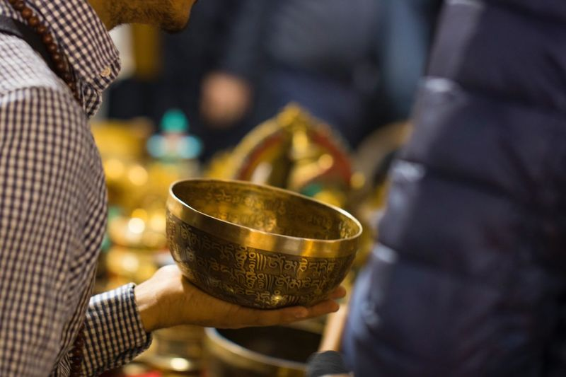 Real People Holding Cultures Midsection Lifestyles Indoors  Human Hand Close-up Women One Person Diya - Oil Lamp Day Tibetan Bell Tibetan  Music