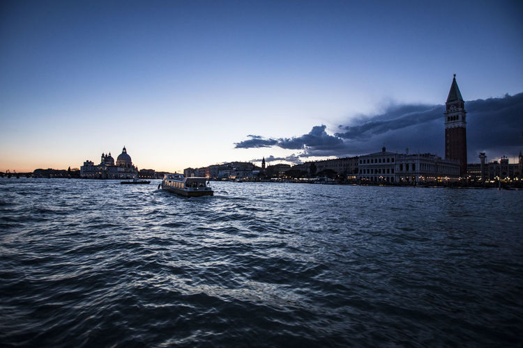 Boats In San Marco Canal At St Marks Square Against Sky During Sunset