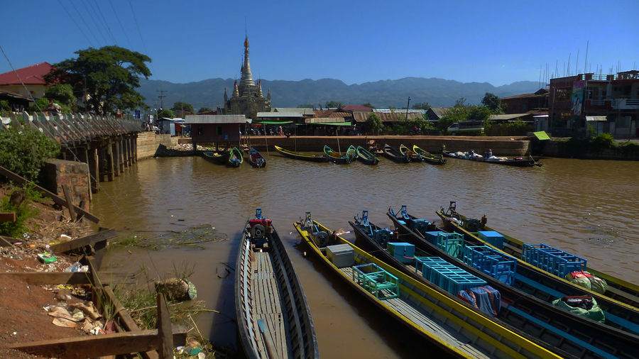 Panoramic view of boats moored in river against sky