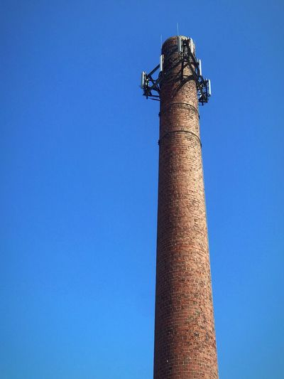 Cellphone Tower Blue Clear Sky Sky Low Angle View Copy Space No People Day Tall - High Built Structure Communication Connection Tower Pole Technology