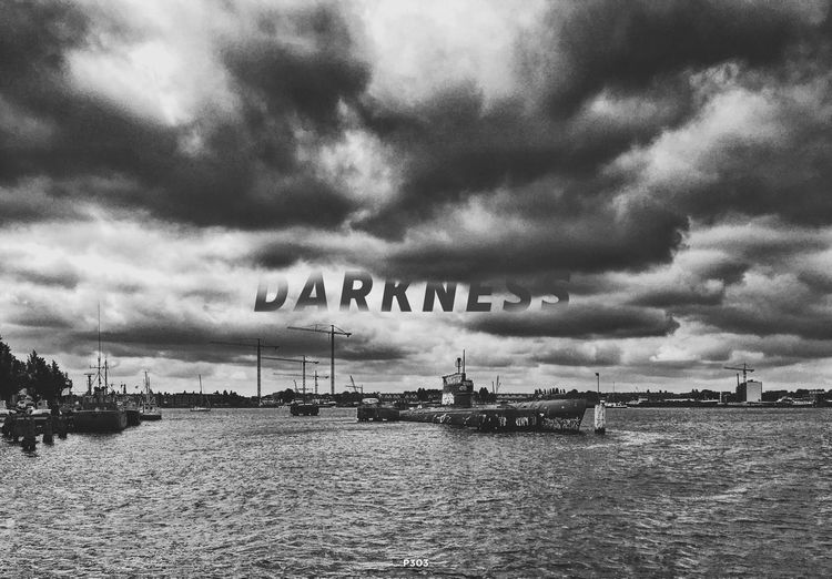 Darkness. P303 Onephotoaday IPhoneography IPhone Editing Typography Blackandwhite Black And White Submarine Last Resting Place 365project2016 Darkness And Light Clouds And Sky Clouds Cloud - Sky Shipwreck Harbour River Riverside Water Cloudy Dutch Skies Outdoors No People Create City View  City