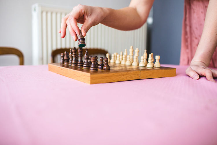 Midsection of woman playing on table