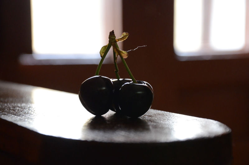 Close-up of cherries on table